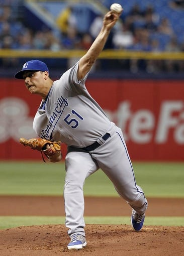 Jul 8, 2014; St. Petersburg, FL, USA; Kansas City Royals starting pitcher Jason Vargas (51) throws a pitch during the first inning against the Tampa Bay Rays at Tropicana Field. Mandatory Credit: Kim Klement-USA TODAY Sports