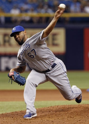 Jul 8, 2014; St. Petersburg, FL, USA; Kansas City Royals relief pitcher Francisley Bueno (67) throws a pitch during the eighth inning against the Tampa Bay Rays at Tropicana Field. Tampa Bay Rays defeated the Kansas City Royals 4-3. Mandatory Credit: Kim Klement-USA TODAY Sports