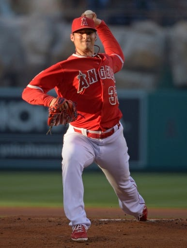 Jun 24, 2014; Anaheim, CA, USA; Los Angeles Angels starter C.J. Wilson (33) delivers a pitch against the Minnesota Twins at Angel Stadium of Anaheim. Mandatory Credit: Kirby Lee-USA TODAY Sports