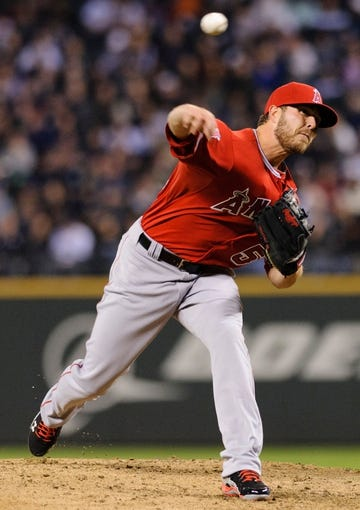 Apr 8, 2014; Seattle, WA, USA; Los Angeles Angels relief pitcher Michael Kohn (58) pitches to the Seattle Mariners during the fifth inning at Safeco Field. Mandatory Credit: Steven Bisig-USA TODAY Sports