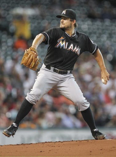 Jul 25, 2014; Houston, TX, USA; Miami Marlins starting pitcher Brad Hand (52) delivers a pitch during the first inning against the Houston Astros at Minute Maid Park. Mandatory Credit: Troy Taormina-USA TODAY Sports