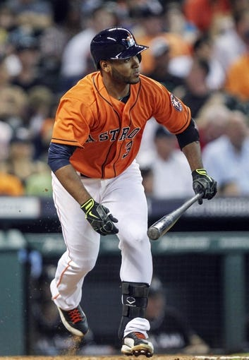 Jul 25, 2014; Houston, TX, USA; Houston Astros shortstop Gregorio Petit (3) gets a single during the third inning against the Miami Marlins at Minute Maid Park. Mandatory Credit: Troy Taormina-USA TODAY Sports