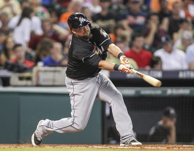 Jul 25, 2014; Houston, TX, USA; Miami Marlins third baseman Casey McGehee (9) gets a single during the fourth inning against the Houston Astros at Minute Maid Park. Mandatory Credit: Troy Taormina-USA TODAY Sports