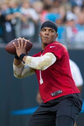 Jul 25, 2014; Charlotte, NC, USA; Carolina Panthers quarterback Cam Newton (1) throws a pass during training camp at Bank of America Stadium. Mandatory Credit: Jeremy Brevard-USA TODAY Sports