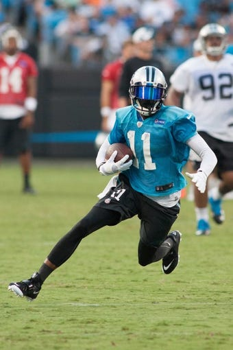 Jul 25, 2014; Charlotte, NC, USA; Carolina Panthers wide receiver Tiquan Underwood (11) runs the ball after catching a pass during training camp at Bank of America Stadium. Mandatory Credit: Jeremy Brevard-USA TODAY Sports