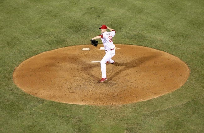 Jul 25, 2014; Philadelphia, PA, USA; Philadelphia Phillies starting pitcher Kyle Kendrick (38) pitches during the fourth inning of a game against the Arizona Diamondbacks at Citizens Bank Park. Mandatory Credit: Bill Streicher-USA TODAY Sports
