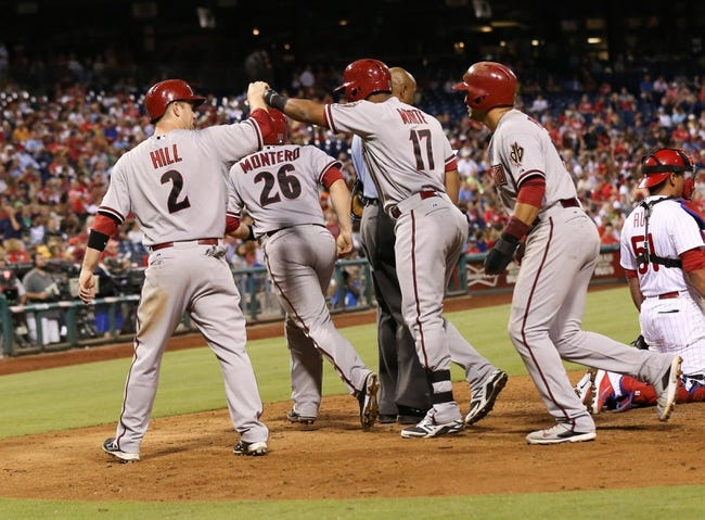 Jul 25, 2014; Philadelphia, PA, USA; Arizona Diamondbacks left fielder Alfredo Marte (17) hits a grand slam home run and is congratulated by second baseman Aaron Hill (2) and catcher Miguel Montero (26) and third baseman Martin Prado (14) during the sixth inning of a game against the Philadelphia Phillies at Citizens Bank Park. Mandatory Credit: Bill Streicher-USA TODAY Sports