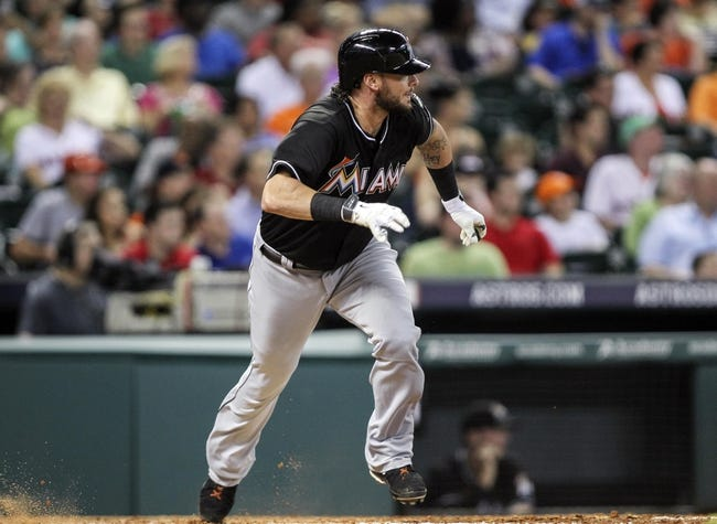Jul 25, 2014; Houston, TX, USA; Miami Marlins designated hitter Jarrod Saltalamacchia (39) hits a double during the fifth inning against the Houston Astros at Minute Maid Park. Mandatory Credit: Troy Taormina-USA TODAY Sports