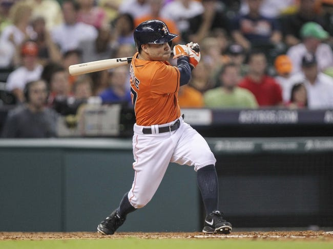 Jul 25, 2014; Houston, TX, USA; Houston Astros second baseman Jose Altuve (27) gets a single during the sixth inning against the Miami Marlins at Minute Maid Park. Mandatory Credit: Troy Taormina-USA TODAY Sports