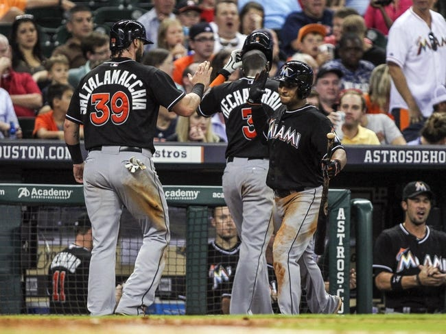 Jul 25, 2014; Houston, TX, USA; Miami Marlins designated hitter Jarrod Saltalamacchia (39) is congratulated by second baseman Donovan Solano (17) after scoring a run during the seventh inning against the Houston Astros at Minute Maid Park. Mandatory Credit: Troy Taormina-USA TODAY Sports