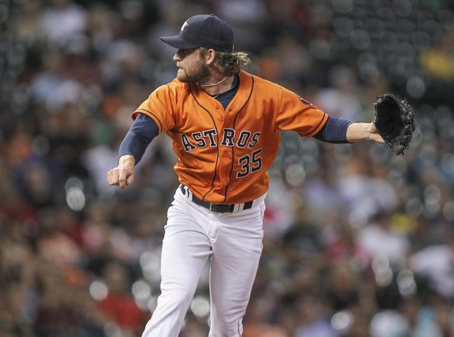 Jul 25, 2014; Houston, TX, USA; Houston Astros relief pitcher Josh Fields (35) pitches during the eighth inning against the Miami Marlins at Minute Maid Park. Mandatory Credit: Troy Taormina-USA TODAY Sports