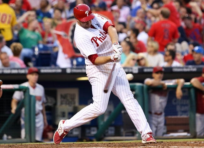 Jul 25, 2014; Philadelphia, PA, USA; Philadelphia Phillies left fielder Darin Ruf (18) hits an RBI sacrifice fly during the third inning of a game against the Arizona Diamondbacks at Citizens Bank Park. Mandatory Credit: Bill Streicher-USA TODAY Sports
