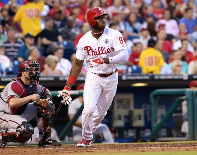 Jul 25, 2014; Philadelphia, PA, USA; Philadelphia Phillies left fielder Domonic Brown (9) hits a double in the third inning of a game against the Arizona Diamondbacks at Citizens Bank Park. Mandatory Credit: Bill Streicher-USA TODAY Sports
