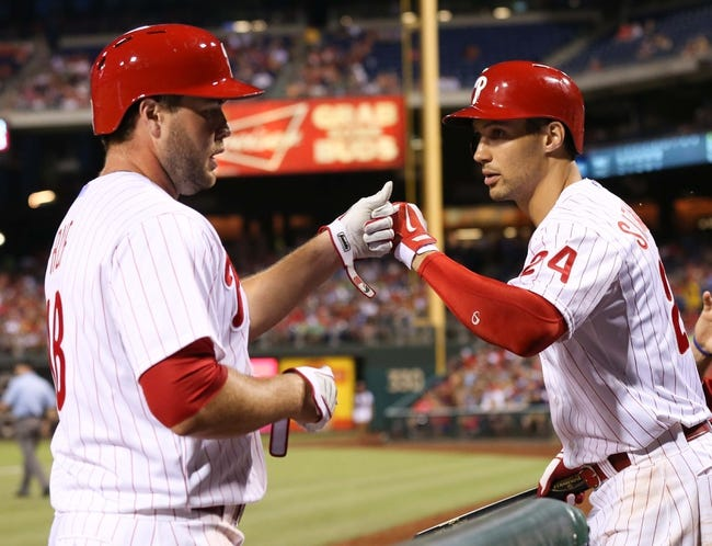 Jul 25, 2014; Philadelphia, PA, USA; Philadelphia Phillies left fielder Darin Ruf (18) is congratulated by left fielder Grady Sizemore (24) after scoring during the fifth inning of a game against the Arizona Diamondbacks at Citizens Bank Park. Mandatory Credit: Bill Streicher-USA TODAY Sports