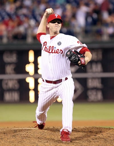 Jul 25, 2014; Philadelphia, PA, USA; Philadelphia Phillies relief pitcher Justin De Fratus (30) pitches seventh inning of a game against the Arizona Diamondbacks  at Citizens Bank Park. The Phillies won 9-5. Mandatory Credit: Bill Streicher-USA TODAY Sports