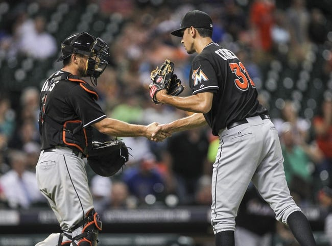Jul 25, 2014; Houston, TX, USA; Miami Marlins catcher Jeff Mathis (6) and relief pitcher Steve Cishek (31) celebrate after defeating the Houston Astros 2-0 at Minute Maid Park. Mandatory Credit: Troy Taormina-USA TODAY Sports