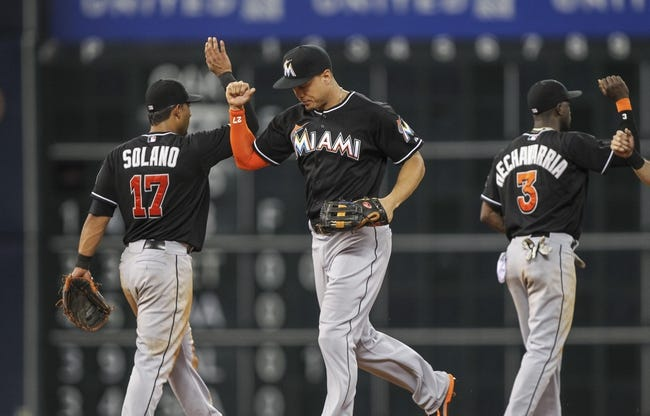 Jul 25, 2014; Houston, TX, USA; Miami Marlins right fielder Giancarlo Stanton (27) celebrates with teammates after the Marlins defeated the Houston Astros 2-0 at Minute Maid Park. Mandatory Credit: Troy Taormina-USA TODAY Sports