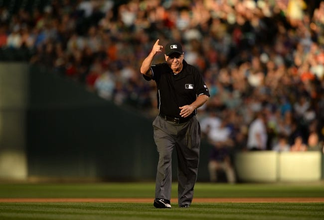 Jul 25, 2014; Denver, CO, USA; MLB umpire Tom Hallion (20) calls for a replay in the fifth inning of the game between the Pittsburgh Pirates and the Colorado Rockies at Coors Field. Mandatory Credit: Ron Chenoy-USA TODAY Sports