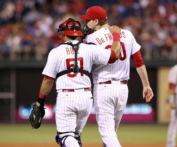 Jul 25, 2014; Philadelphia, PA, USA; Philadelphia Phillies catcher Carlos Ruiz (51) and relief pitcher Justin De Fratus (30) talk as they walk to the mound during the seventh inning of a game against the Arizona Diamondbacks at Citizens Bank Park. The Phillies won 9-5. Mandatory Credit: Bill Streicher-USA TODAY Sports