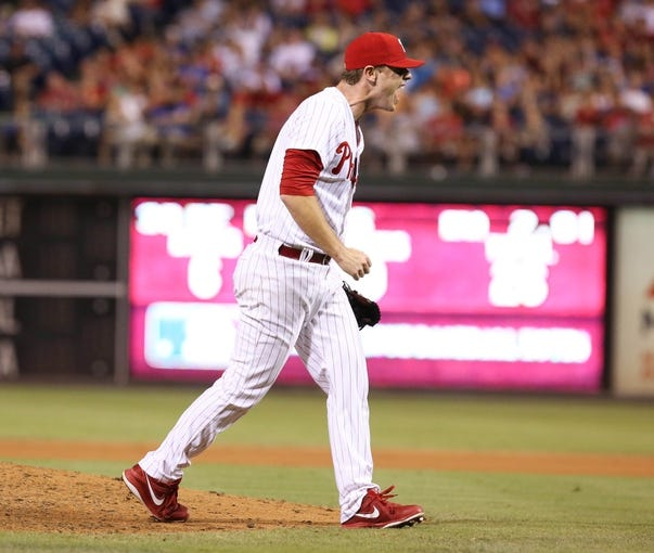 Jul 25, 2014; Philadelphia, PA, USA; Philadelphia Phillies relief pitcher Justin De Fratus (30) reacts after a strike out to end the seventh inning of a game against the Arizona Diamondbacks  at Citizens Bank Park. The Phillies won 9-5. Mandatory Credit: Bill Streicher-USA TODAY Sports