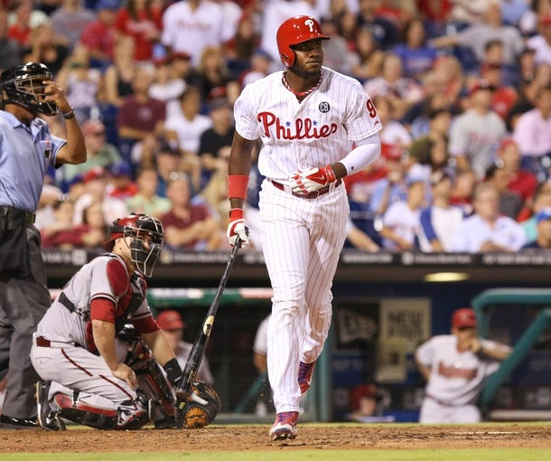 Jul 25, 2014; Philadelphia, PA, USA; Philadelphia Phillies left fielder Domonic Brown (9) hits a two RBI home run during the seventh inning of a game against the Arizona Diamondbacks at Citizens Bank Park. The Phillies won 9-5. Mandatory Credit: Bill Streicher-USA TODAY Sports