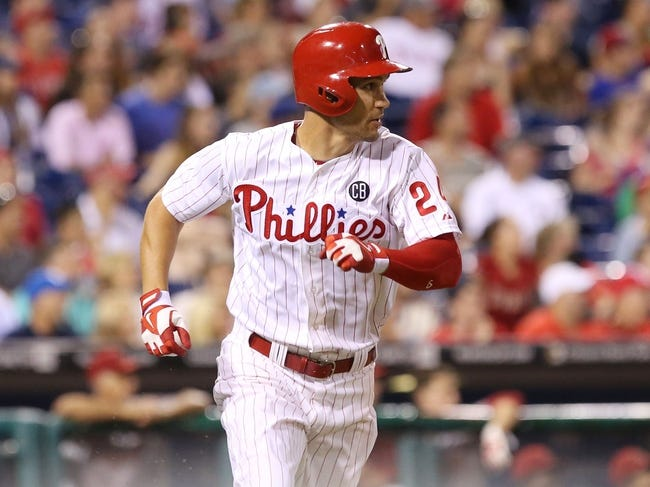 Jul 25, 2014; Philadelphia, PA, USA; Philadelphia Phillies left fielder Grady Sizemore (24) hits an RBI double during the eighth inning of a game against the Arizona Diamondbacks at Citizens Bank Park. The Phillies won 9-5. Mandatory Credit: Bill Streicher-USA TODAY Sports