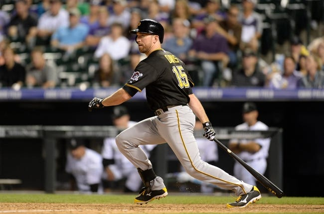 Jul 25, 2014; Denver, CO, USA; Pittsburgh Pirates first baseman Ike Davis (15) singles in the ninth inning against the Colorado Rockies at Coors Field. The Rockies defeated the Pirates 8-1. Mandatory Credit: Ron Chenoy-USA TODAY Sports