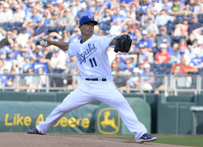 Jul 26, 2014; Kansas City, MO, USA; Kansas City Royals starting pitcher Jeremy Guthrie (11) delivers a pitch against the Cleveland Indians in the first inning at Kauffman Stadium. Mandatory Credit: John Rieger-USA TODAY Sports
