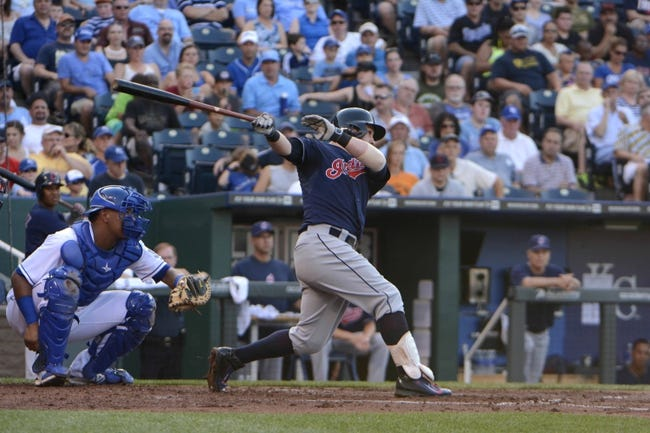 Jul 26, 2014; Kansas City, MO, USA; Cleveland Indians second baseman Jason Kipnis (22) drive-in 2 runs with a double against the Kansas City Royals in the second inning at Kauffman Stadium. Mandatory Credit: John Rieger-USA TODAY Sports