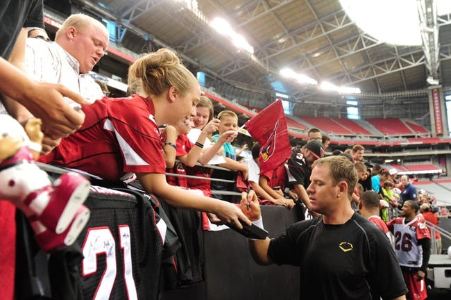 Jul 26, 2014; Tempe, AZ, USA; Arizona Cardinals quarterback Carson Palmer (3) signs autographs for fans during training camp at University of Phoenix. Mandatory Credit: Matt Kartozian-USA TODAY Sports