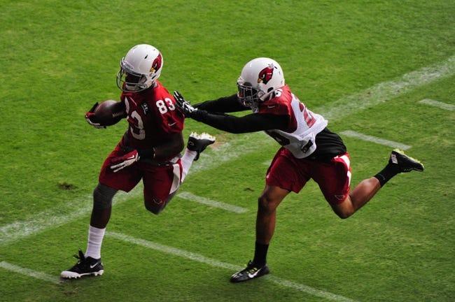 Jul 26, 2014; Tempe, AZ, USA; Arizona Cardinals wide receiver Walt Powell (83) runs with the ball after a catch as free safety Rashad Johnson (26) defends during training camp at University of Phoenix. Mandatory Credit: Matt Kartozian-USA TODAY Sports