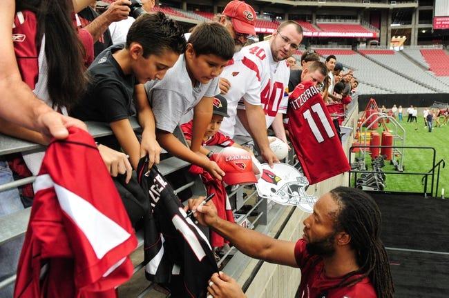 Jul 26, 2014; Tempe, AZ, USA; Arizona Cardinals wide receiver Larry Fitzgerald (11) signs autographs for fans during training camp at University of Phoenix. Mandatory Credit: Matt Kartozian-USA TODAY Sports