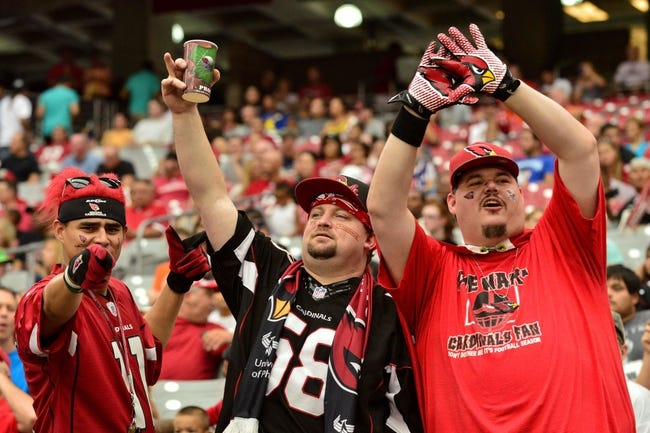 Jul 26, 2014; Tempe, AZ, USA; Arizona Cardinals cheers during training camp at University of Phoenix. Mandatory Credit: Matt Kartozian-USA TODAY Sports