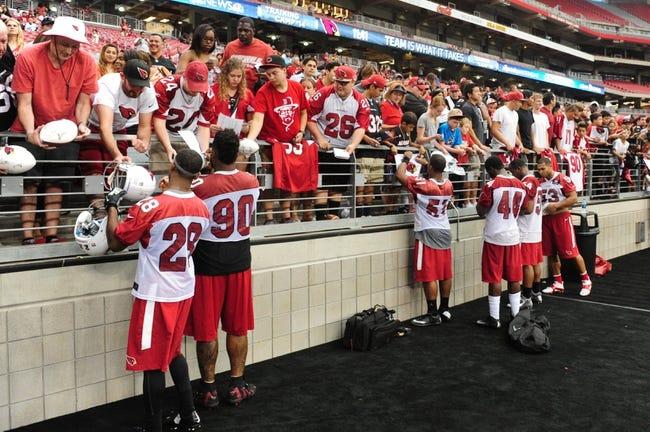 Jul 26, 2014; Tempe, AZ, USA; Members of the Arizona Cardinals sign autographs for fans during training camp at University of Phoenix. Mandatory Credit: Matt Kartozian-USA TODAY Sports