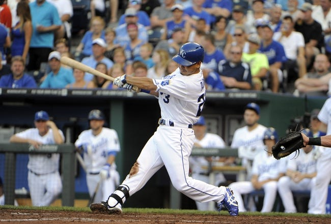 Jul 26, 2014; Kansas City, MO, USA; Kansas City Royals right fielder Norichika Aoki (23) drives in two runs with a triple in the fourth inning against the Cleveland Indians at Kauffman Stadium. Mandatory Credit: John Rieger-USA TODAY Sports