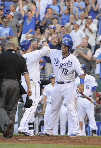Jul 26, 2014; Kansas City, MO, USA; Kansas City Royals designated hitter Billy Butler (16) celebrates with catcher Salvador Perez (13) after hitting a two run home run in the fifth inning against the Cleveland Indians at Kauffman Stadium. Mandatory Credit: John Rieger-USA TODAY Sports