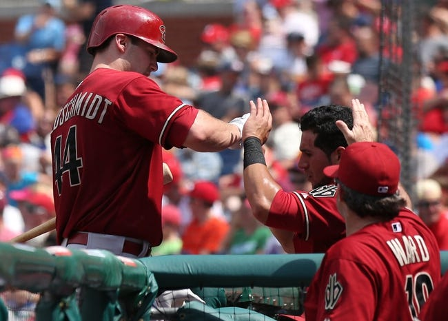 Jul 27, 2014; Philadelphia, PA, USA; Arizona Diamondbacks first baseman Paul Goldschmidt (44) celebrates with teammates in the dugout after hitting an RBI sacrifice fly during the sixth inning against the Philadelphia Phillies at Citizens Bank Park. The Phillies won 4-2. Mandatory Credit: Bill Streicher-USA TODAY Sports
