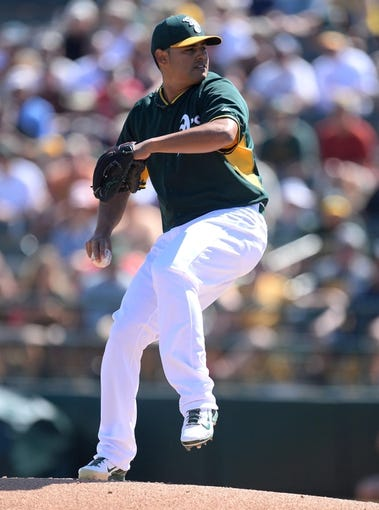 Mar 15, 2014; Phoenix, AZ, USA; Oakland Athletics relief pitcher Arnold Leon (68) pitches in the first inning against the Texas Rangers at Phoenix Municipal Stadium. Mandatory Credit: Joe Camporeale-USA TODAY Sports