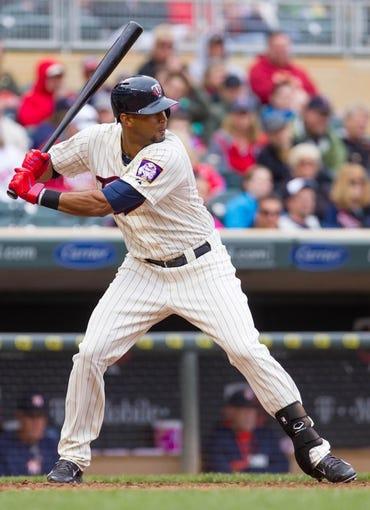 Jun 7, 2014; Minneapolis, MN, USA; Minnesota Twins center fielder Aaron Hicks (32) at bat against the Houston Astros at Target Field. Mandatory Credit: Brad Rempel-USA TODAY Sports