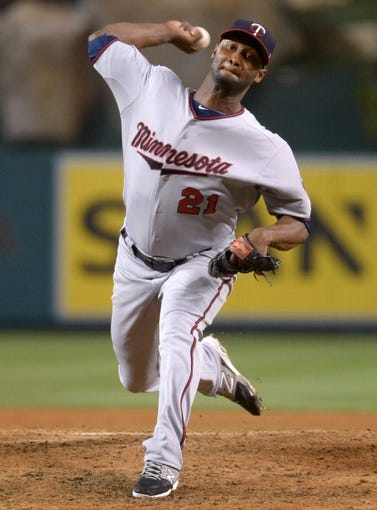 Jun 24, 2014; Anaheim, CA, USA; Minnesota Twins reliever Samuel Deduno (21) delivers a pitch against the Los Angeles Angels at Angel Stadium of Anaheim. The Angels defeated the Twins 8-6. Mandatory Credit: Kirby Lee-USA TODAY Sports