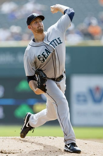 Sep 18, 2013; Detroit, MI, USA; Seattle Mariners starting pitcher James Paxton (65) pitches in the first inning against the Detroit Tigers at Comerica Park. Mandatory Credit: Rick Osentoski-USA TODAY Sports