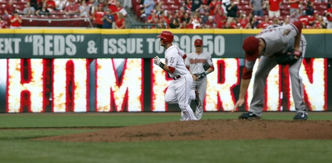 Jul 28, 2014; Cincinnati, OH, USA; Cincinnati Reds catcher Devin Mesoraco (39) rounds the bases after hitting a solo home run off Arizona Diamondbacks starting pitcher Chase Anderson (right) in the first inning at Great American Ball Park. Mandatory Credit: David Kohl-USA TODAY Sports