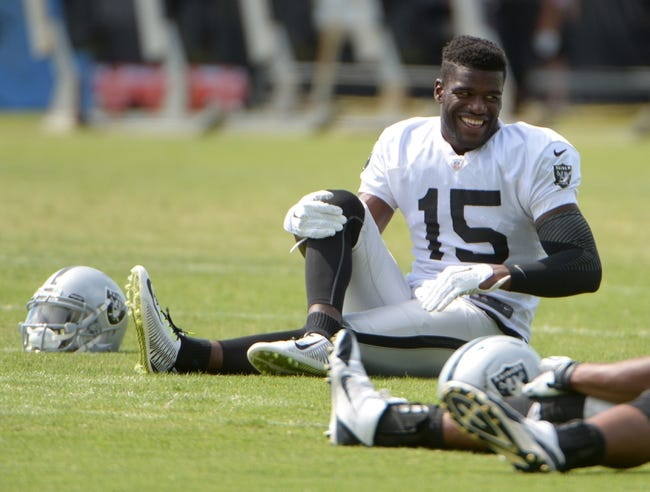Jul 28, 2014; Napa, CA, USA; Oakland Raiders receiver Greg Little (15) stretches at training camp at Napa Valley Marriott. Mandatory Credit: Kirby Lee-USA TODAY Sports