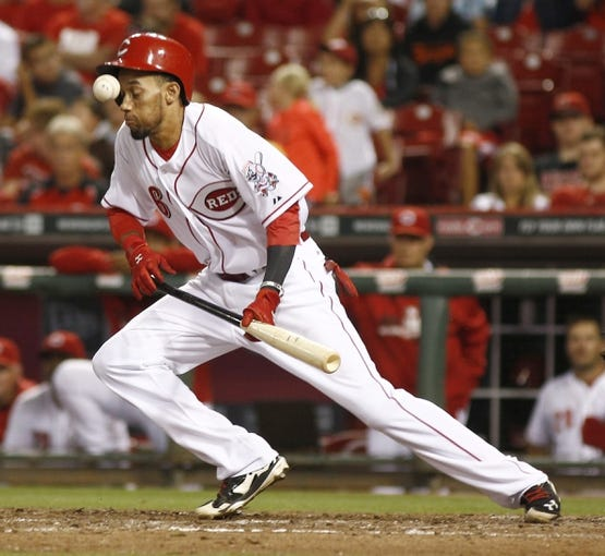Jul 28, 2014; Cincinnati, OH, USA; Cincinnati Reds center fielder Billy Hamilton (6) is hit by the ball after bunting in the eleventh inning during a game against the Arizona Diamondbacks at Great American Ball Park. The Diamondbacks won 2-1 in 15 innings. Mandatory Credit: David Kohl-USA TODAY Sports