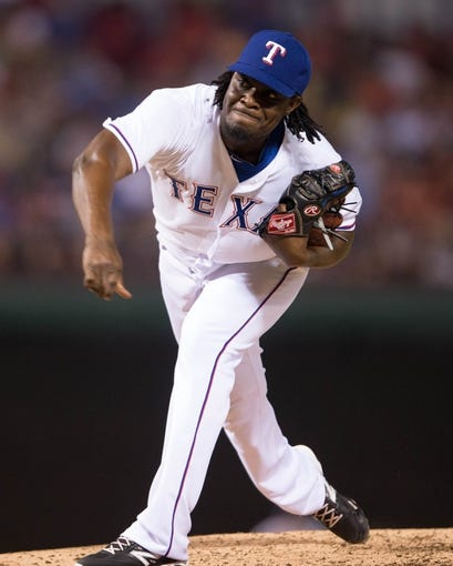Jul 25, 2014; Arlington, TX, USA; Texas Rangers relief pitcher Roman Mendez (55) pitches during the game against the Oakland Athletics at Globe Life Park in Arlington. The Rangers defeated the Athletics 4-1. Mandatory Credit: Jerome Miron-USA TODAY Sports