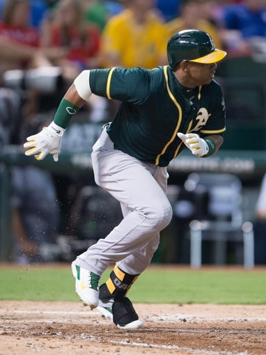 Jul 25, 2014; Arlington, TX, USA; Oakland Athletics center fielder Yoenis Cespedes (52) runs the bases during the game against the Texas Rangers at Globe Life Park in Arlington. The Rangers defeated the Athletics 4-1. Mandatory Credit: Jerome Miron-USA TODAY Sports