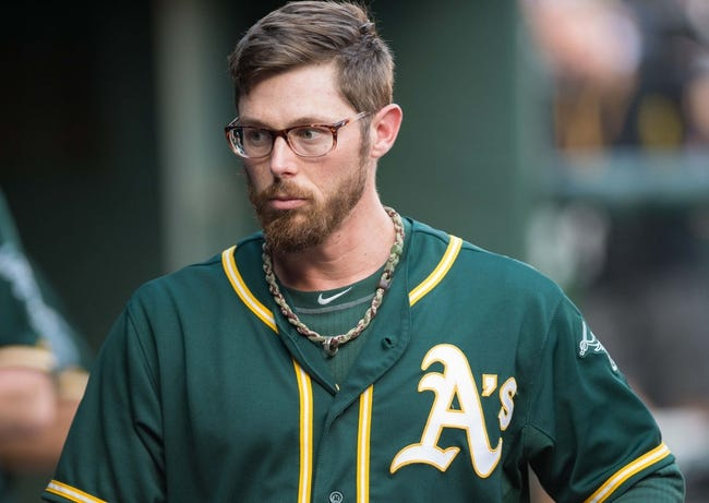 Jul 25, 2014; Arlington, TX, USA; Oakland Athletics second baseman Eric Sogard (28) during the game against the Texas Rangers at Globe Life Park in Arlington. The Rangers defeated the Athletics 4-1. Mandatory Credit: Jerome Miron-USA TODAY Sports