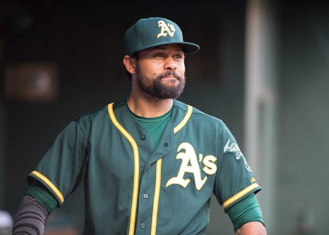 Jul 25, 2014; Arlington, TX, USA; Oakland Athletics center fielder Coco Crisp (4) during the game against the Texas Rangers at Globe Life Park in Arlington. The Rangers defeated the Athletics 4-1. Mandatory Credit: Jerome Miron-USA TODAY Sports