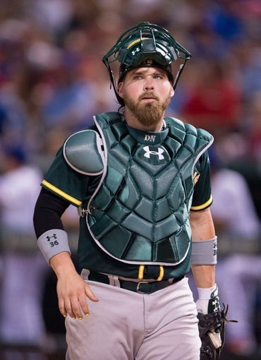 Jul 25, 2014; Arlington, TX, USA; Oakland Athletics catcher Derek Norris (36) during the game against the Texas Rangers at Globe Life Park in Arlington. The Rangers defeated the Athletics 4-1. Mandatory Credit: Jerome Miron-USA TODAY Sports