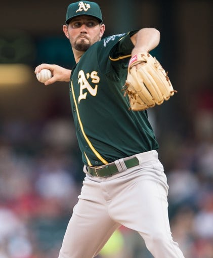 Jul 25, 2014; Arlington, TX, USA; Oakland Athletics starting pitcher Jason Hammel (40) pitches during the game against the Texas Rangers at Globe Life Park in Arlington. The Rangers defeated the Athletics 4-1. Mandatory Credit: Jerome Miron-USA TODAY Sports